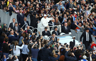 Pope Francis waves at the end of a mass to mark the closing of the Catholic Jubilee Year of Mercy in Saint Peter's Square at the Vatican