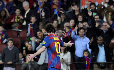 Barcelona's Lionel Messi gestures to the crowd as he celebrates a goal against Athletic Bilbao during their Spanish First division soccer league match at Camp Nou stadium in Barcelona