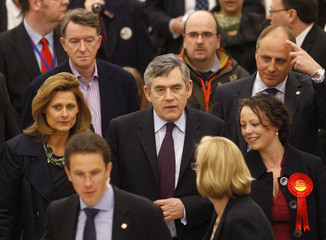 Britain's Prime Minister Gordon Brown walks through a supermarket with his wife Sarah and Business Secretary Peter Mandelson during a campaign stop in Newcastle