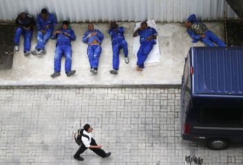 Workers from the Rio Museum of Art (MAR) relax during their lunch time, in Rio de Janeiro