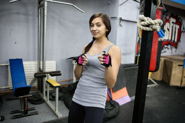 Portrait of an attractive brunette girl in a gym
