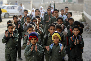Students participate in a morning exercise before classes which were conducted outside their school that was taken over by Shi'ite Houthi rebels in Sanaa