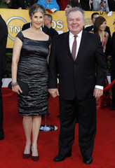 """Actor Jack McGee from the movie """"The Fighter"""" and his wife Stephanie arrive at the 17th annual Screen Actors Guild Awards in Los Angeles"""