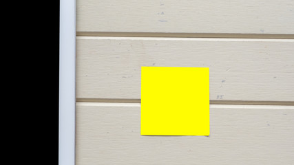 Wall Mural - taplet with post it close up on wood background