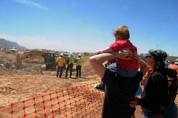 Spectators watch the progress as workers search the old Alamlgordo landfill for buried Atari games in Alamogordo