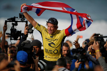 John John Florence of Hawaii celebrates his victory after winning the WSL championship at Supertubo beach in Peniche