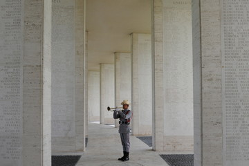 A Philippine Army soldier plays Taps during a U.S. Memorial Day ceremony at the American cemetery in Taguig city, metro Manila