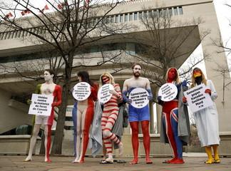 PETA activists protest seal hunts outside Canadian Embassy in Washington