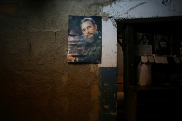 """An image of late Cuban President Fidel Castro is seen at a subsidised state store, or """"bodega"""", where Cubans can buy basic products with a ration book they receive annually from the government in downtown Havana, Cuba"""