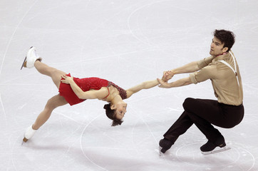 Duhamel and Radford of Canada perform their pairs short program at the ISU World Figure Skating Championships in London