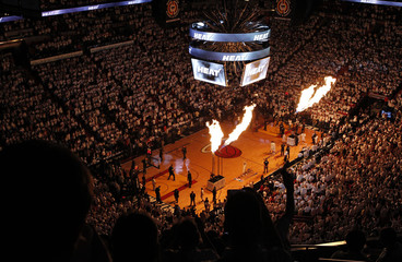 Fans watch as players are introduced prior to Game 7 of their Eastern Conference Finals NBA basketball playoff series between the Miami Heat and the Boston Celtics in Miami
