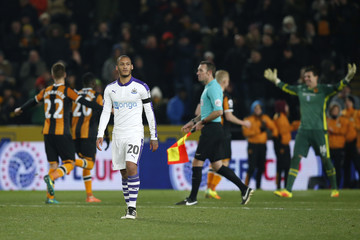 Newcastle United's Yoan Gouffran looks dejected after missing a penalty during the shootout as Hull players celebrate winning the match