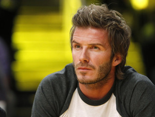 Soccer player Beckham attends NBA basketball game between Los Angeles Lakers and Memphis Grizzlies in Los Angeles