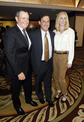 Fogelson, chairman of Universal Pictures, and his wife Hillary pose with President of Academy of Motion Pictures, Arts and Sciences Tom Sherak at the National Multiple Sclerosis Society's 36th annual Dinner of Champions in Los Angeles