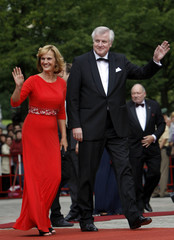 Bavarian Prime Minister Horst Seehofer and his wife Karin arrive for the opening of the Wagner opera festival in Bayreuth