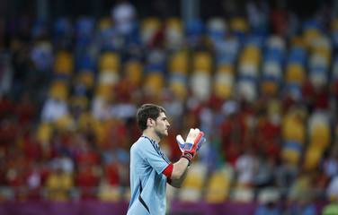 Spain's Casillas walks on the pitch before the Euro 2012 final soccer match against Italy at the Olympic Stadium in Kiev