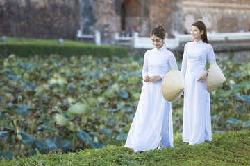 Vietnamese girl dressed in lotus pond