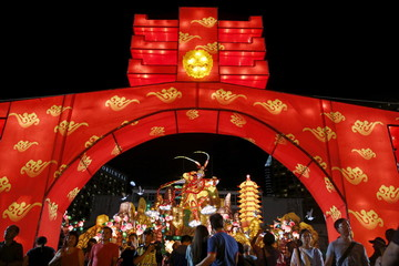 People pass a Monkey King lantern at the River Hongbao Lunar New Year celebrations at the Marina Bay floating platform in Singapore