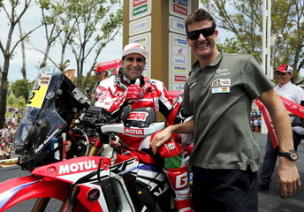 Honda motorcycle rider Goncalves of Portugal poses for a photo with Dakar Rally Sporting Director Coma of Spain during the departure ceremony for Dakar Rally 2016 in Buenos Aires