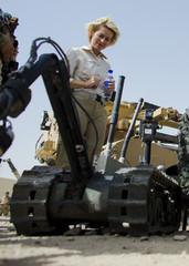 German Defence Minister Ursula von der Leyen looks at a U.S. radio controlled bomb disposal robot at Camp Marmal outside Mazar-i-Sharif