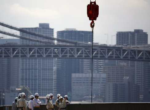 Men wearing hardhats inspect construction site in Tokyo