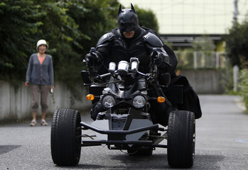 "A 41-year-old man going by the name of Chibatman leaves his home on his ""Chibatpod"" in Chiba, east of Tokyo"