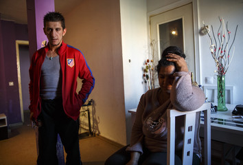 Teresa Jimenez and her husband Luis Miguel Martin wait before learning that their eviction was suspended in Torrejon de Ardoz, near Madrid
