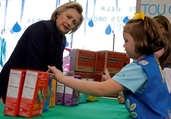 U.S. Democratic presidential candidate Hillary Clinton speaks to Girl Scouts' about buying some cookies during a campaign event in Ashland