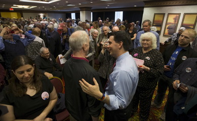 Walker greets supporters at a rally in Cedar Rapids