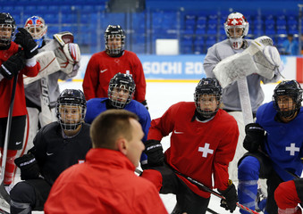Members of the Switzerland women's ice hockey team attend practice in the Shayba Arena ahead of the 2014 Sochi Winter Olympics