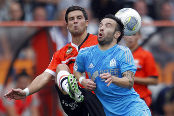 FC Lorient's Coutadeur challenges Olympique Marseille's Valbuena during their French Ligue 1 soccer match in Lorient