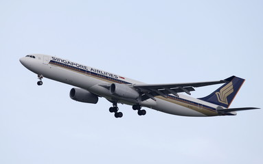 A Singapore Airlines Airbus A330 plane approaches Singapore's Changi Airport