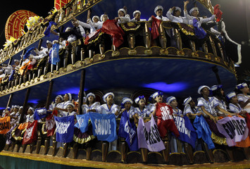 Revelers from the Gavioes da Fiel Samba School take part in carnival at Anhembi Sambadrome in Sao Paulo