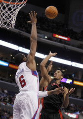 Toronto Raptors guard DeRozan lets go shot over Los Angeles Clippers center Jordan during second half of their NBA basketball game in Los Angeles