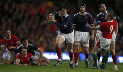 France's Trinh-Duc runs for the line to score a try during their Six Nations rugby union match against Wales at the Millennium Stadium in Cardiff