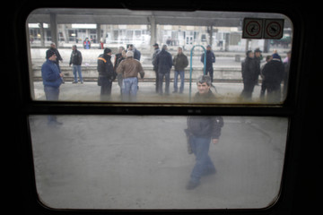 Bulgarian railway workers are seen through a train window during a protest at the central railway station in Sofia