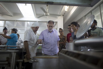 U.S. director Francis Ford Coppola prepares pasta in the kitchen of the International School of Cinema and Television (EICTV) in San Antonio de los Banos, Cuba