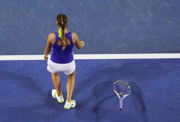 Azarenka of Belarus drops her racquet after defeating Sharapova of Russia in their women's singles final match at the Australian Open tennis tournament in Melbourne