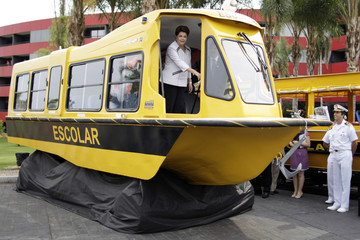 Brazil's President Rousseff enters a school ship, which will transport children to schools in Brazil, during a seminar on government procurement, in the hotel Royal Tulip Brasilia Alvorada in Brasilia