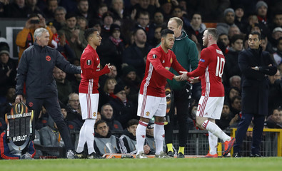 Manchester United's Memphis Depay comes on as a substitute to replace Wayne Rooney as Jesse Lingard looks on