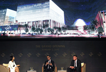 Ho, co-Chairman and CEO of Melco Crown Entertainment Ltd, gestures during a news conference and grand opening of the City of Dreams in Manila