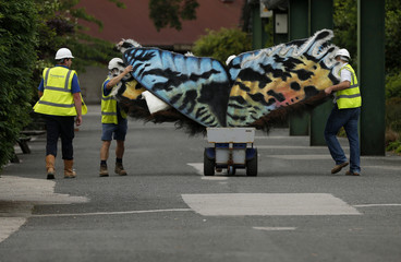 Workers push a set of giant Butterfly wings through the grounds of Chester Zoo in northern England