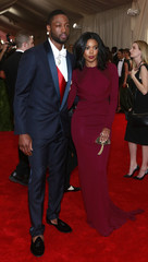 """Wade of the Miami Heat NBA basketball team and wife actress Gabrielle arrive for the Metropolitan Museum of Art Costume Institute Gala 2015 celebrating the opening of """"China: Through the Looking Glass,"""" in Manhattan"""