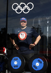 U.S bobsled pilot Steve Holcomb poses for a picture at the fitness center in the Coastal Cluster Olympic Village in Sochi
