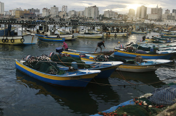 Palestinian fishermen ride in fishing boats at Gaza Seaport in Gaza City