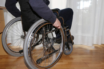Wheelchair in the bedroom of the disabled man