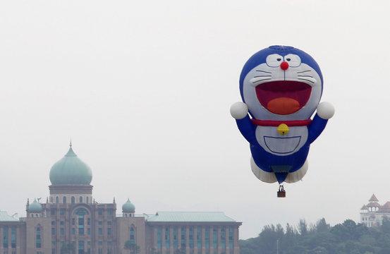 "File photo of ""Doraemon"" hot air balloon floats over Malaysia's landmark Putra Perdana in Putrajaya"