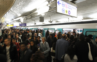 Commuters crowd into a metro at Saint-Lazare metro station in Paris