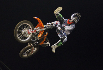 Dany Torres of Spain performs with his motorcycle during a freestyle show in San Jose