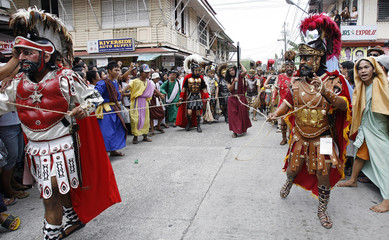 Residents take part in a Station of the Cross as part of the observance of Good Friday in Marinduque island